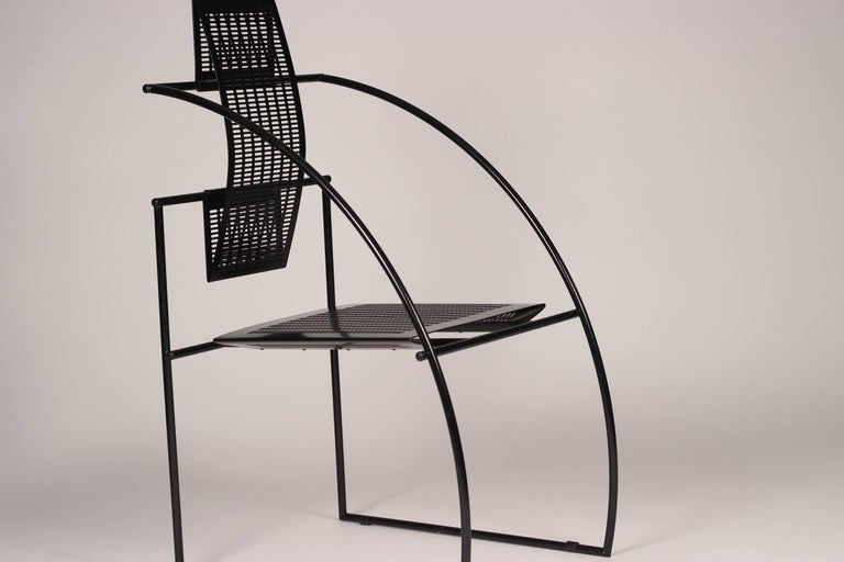 The Quinta chair by Italian architect and designer Mario Botta is constructed of a steel rod frame and perforated steel to form the seat and back.