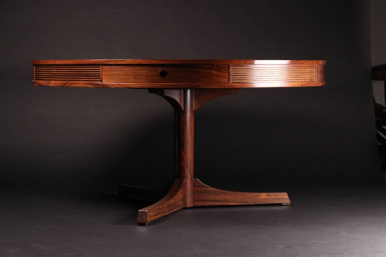 Designed by the highly respected Robert Heritage and made by the wonderful sounding Archie Shine Ltd. This piece was retailed at the World famous furniture store Heals of London, circa 1965. A large beautiful and highly distinctive grained Rosewood
