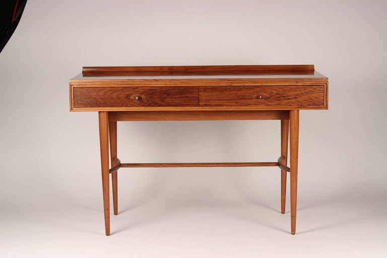 A versatile desk from the English maker and wonderfully sounding Archie Shine. Robert Heritage worked on a number of pieces including the Hamilton range which included sideboards and tables. This desk functions equally well as a writing table or