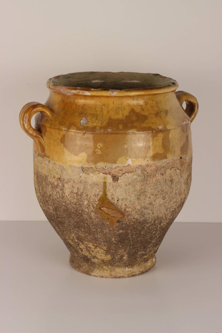 Antique French glazed terracotta confit pot in very nice original condition. These pots were used primarily in the South of France for the preservation of meats such as duck or goose for dishes like cassoulet or foie gras. The bottom halves were