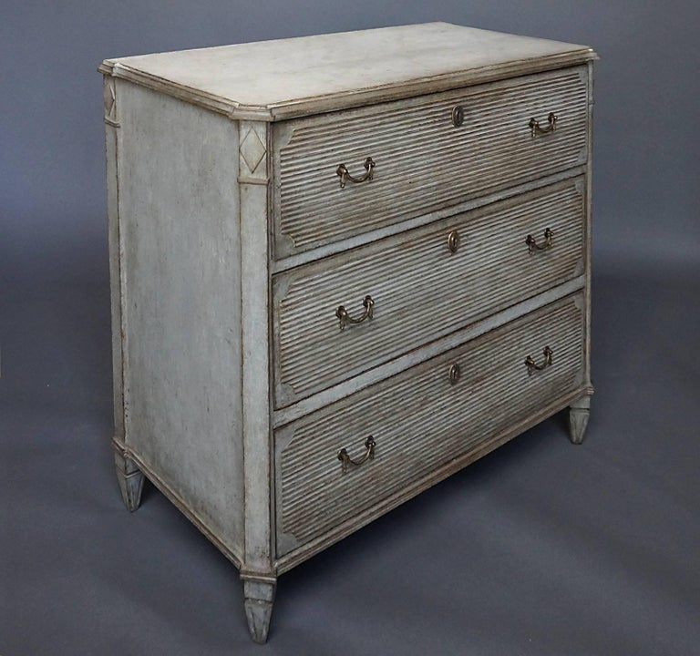Gustavian style chest of drawers with reeded drawer fronts, Sweden, circa 1860. Canted corners with lozenge detail. Shaped top.  No repairs; original hardware.