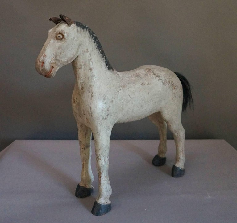 Sweden's first toy factory was opened in Gemla in 1866, and this sturdy horse was made shortly after that date, circa 1870. He has a friendly, alert expression with perked leather ears and painted eyes. The mane is painted, but his tail is real