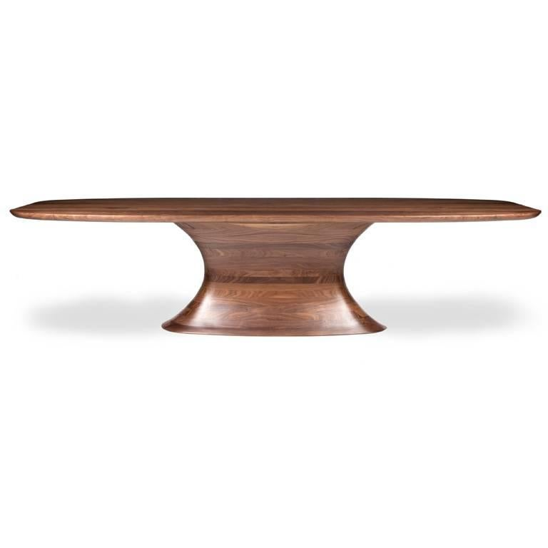 Contemporary Concave Dining Table in Black Walnut with Lacquer Finish. Dining table in solid American black walnut hand-sculpted to reveal an elliptical concave form. American black walnut, polyurethane lacquer finish Hand sculpting, stack