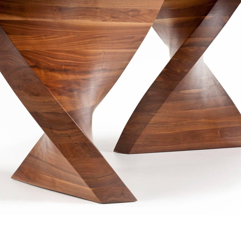 Hand-sculpted dining table in solid American black walnut. Finished with a hard wearing Polyurethane lacquer finish. Available to order, can be customized to suit client dimensions.