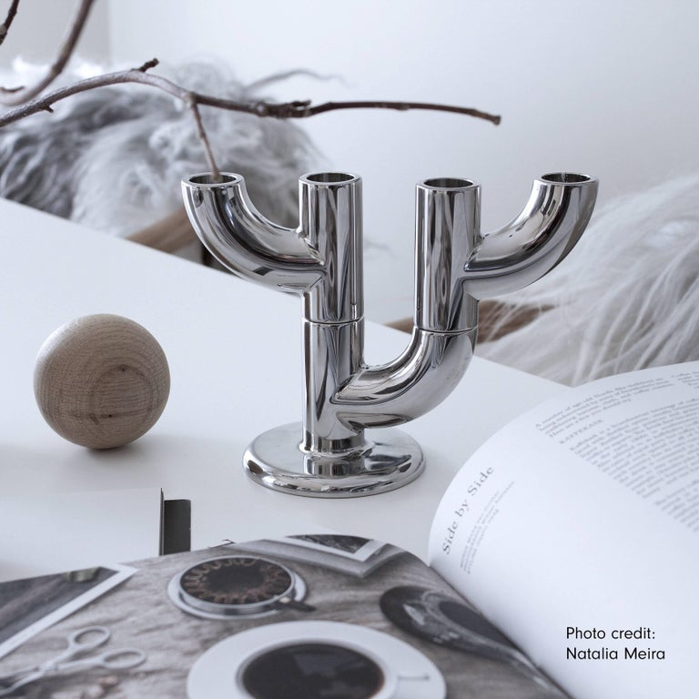 The Alia candleholder is modular and stackable. Designed into two basic forms, it allows users to transform and place the candleholder in various different ways. The body of the candleholder is cast in zinc alloy and the surface is chrome plating