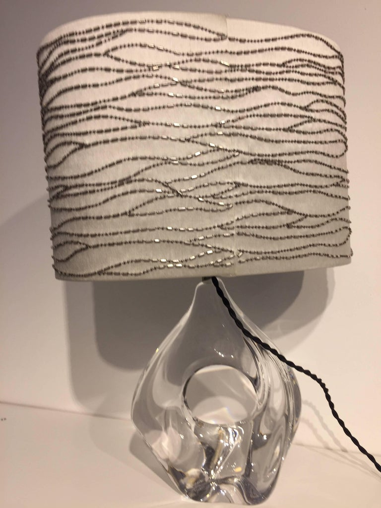 Beautiful amorphic table Light, clear crystal, free hand-formed by Michel Daum, France, produced 1958, signed on the Bottom Daum France, new textile wiring (textile cable color black) with UK plug, size of crystal base 22cm H x 19cm W x 9cm D, Total