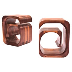 A pair of sculptural bedside Tables in solid walnut by Jonathan Field