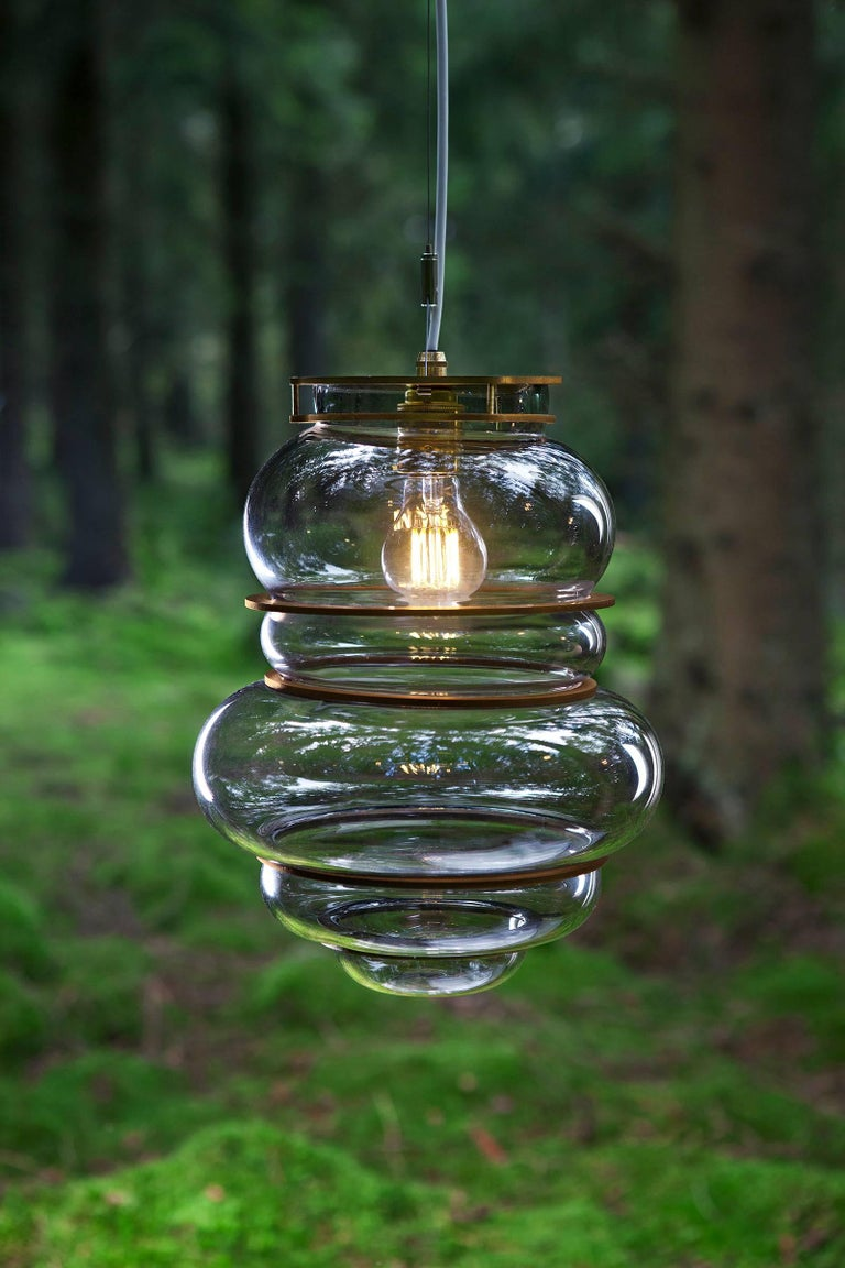 Modern Contemporary Minor Flaws, Mouth Blown Glass Pendant with Brass Rings For Sale