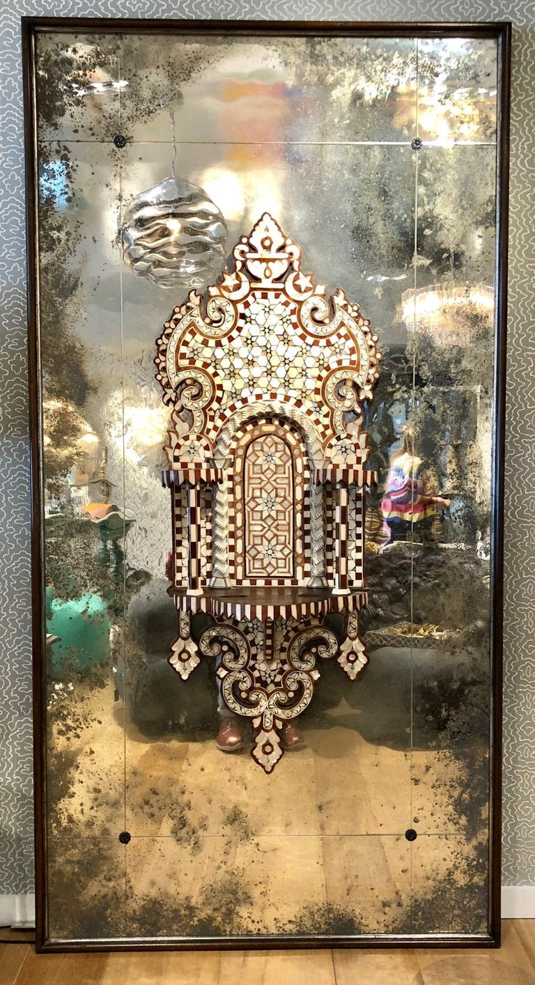 Mother of pearl and bone inlay shelving brackets mounted on heavily distressed gilded frames with antique plate glass mirrors, Syria ca 1880. In very good condition. Prepared for cleat hanging.