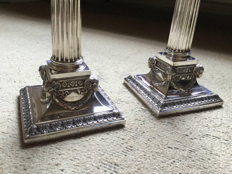 A fine pair of Victorian George III style Corinthian silver plated candlesticks, circa 1875.