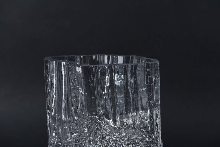 A wonderful clear, molded ice glass vase by Tapio Wirkkala for Iittala, circa 1970s. Very interesting shape and texture, resembling that of ice.