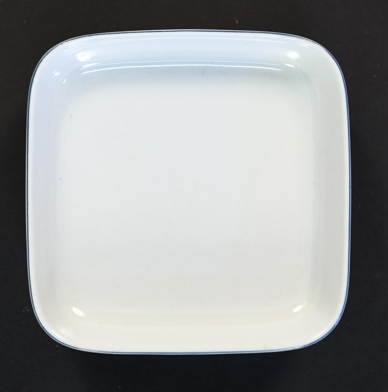 Rare Grethe Meyer (1918-2008) blue line aluminia (Royal Copenhagen) porcelain dinnerware set, designed in 1965.  Service includes: One square butter, two creamer and lids, one 8