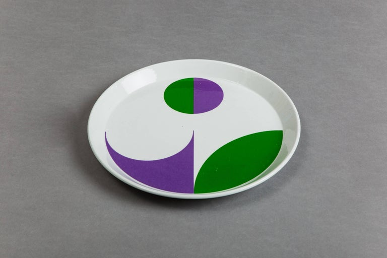 Glazed porcelain plates. Single earlier plate with simple element and later three plates with complex elements deriving from the intersection of circles in positive and negative. Signed with stamped manufacturer's mark.