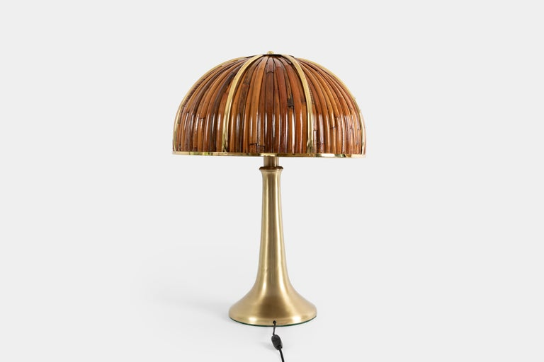 Large and striking 'Fungo' table lamp from the iconic Rising Sun Series with lacquered bamboo and polished brass dome shade and elegant flared brass base in a brushed gold finish. Impressed with facsimile signature and artist's cipher to shade and