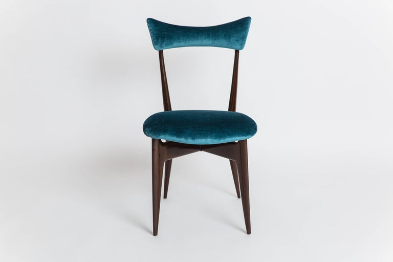 Ico & Luisa Parisi for Ariberto Colombo, Cantù, set of six rare rosewood or palissander sculptural dining chairs, 1950.  Sculptural frame with padded seat suspended on the pointed corner supports of the underlying x-shaped frame; padded backrest