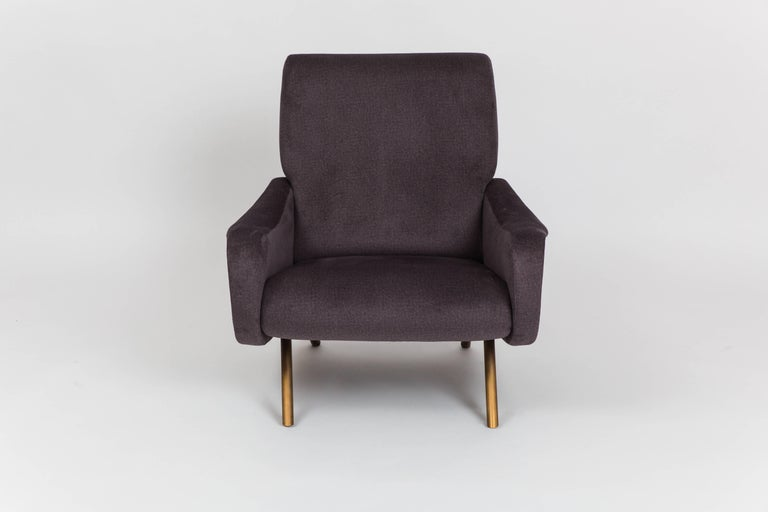 Marco Zanuso for Arflex early pair of 'Lady' chairs or lounge chairs with steel structure, foam rubber seat and back upholstered in charcoal gray cotton velvet, and tubular brass legs, Italy, 1950s. This model is a sleek, iconic design and was