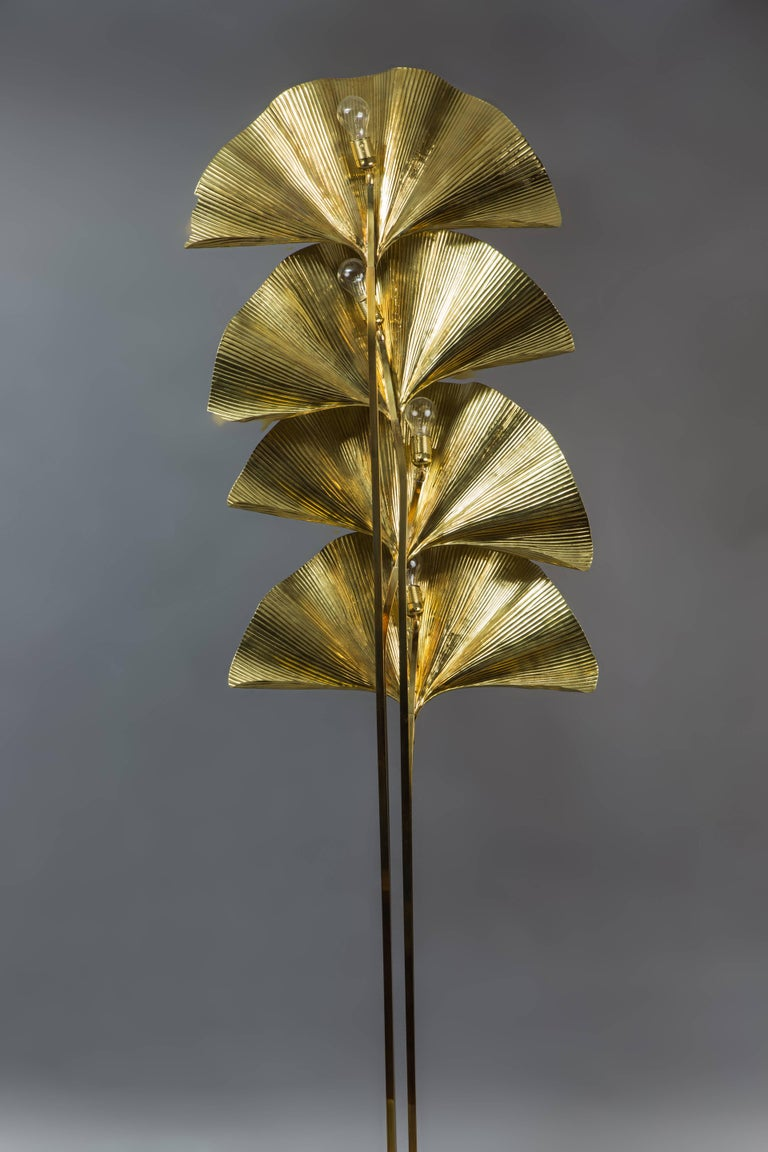Large and elegant patinated gilt brass four-leaf ginkgo floor lamp with undulating embossed leaves, handmade using repoussé and chasing techniques, mounted on stems attached to square base, Italy, 1970s.  Rewired to U.S. standards.  In 1970 Bottega