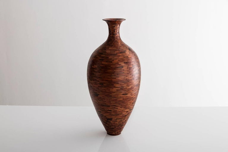 Part of Richard Haining's Stacked Collection, this vase was made using reclaimed California redwood salvaged from a decommissioned NYC water tower. The wood's natural coloring shows off tones ranging from pink and deep reds to almost black in color.