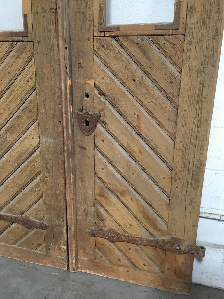 Beautiful wooden doors with iron hardware, wonderfully preserved. No key, but all working latches and parts.