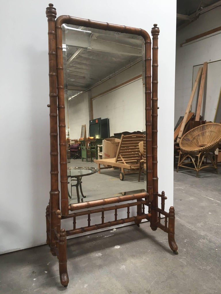 Beautiful faux bamboo cheval psyche full length mirror. Original brass hardware attaches mirror to rolling frame. Adds the perfect accent to you bedroom or dressing area.