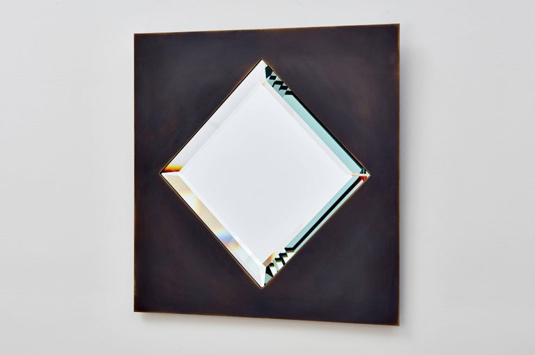 Bark Frameworks created this custom mirror about 20 years ago, naming it Dakhla after the coastal Moroccan town. The mirror frame is a thick sheet of copper, patinated to a dark sheen -- like the desert in the Western Sahara, it seems to have no