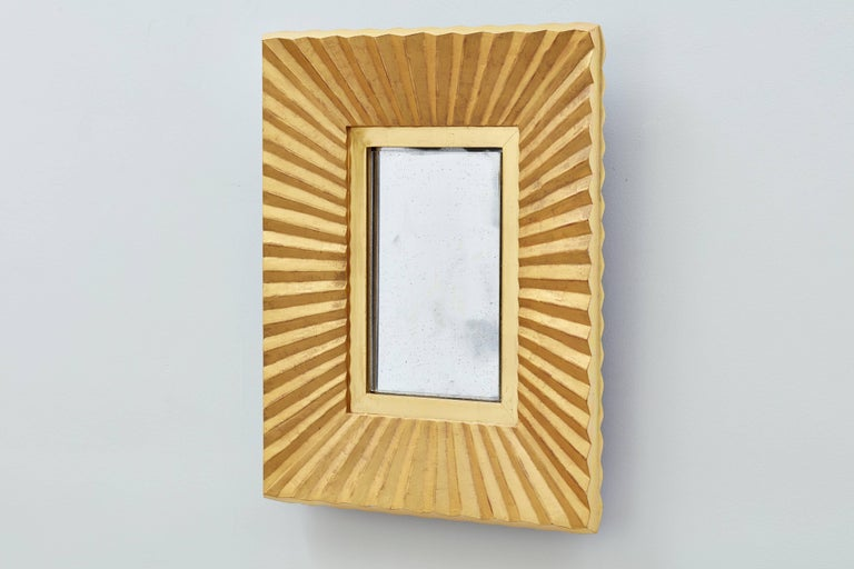 Pleated facets inform the name of this Bark Frameworks mirror, which was designed by company founder and artist Jared Bark. The entire maple frame is gilded in 23-karat yellow gold over dark red bole (clay). The pleats are matte; the inner panel and