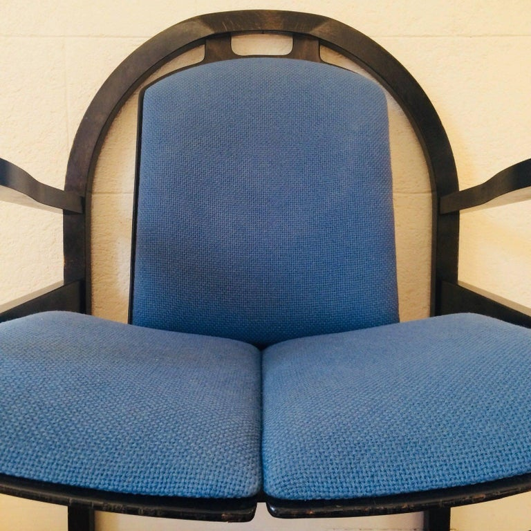 Baumann armchair model Argos, circa 1978. Black stained beech. Original woollen cushions very good condition Blue One small snag on a cushion Measures: H 86 X L 61 x D 63 cm seat 46 cm. Very decorative. Excellent original condition.