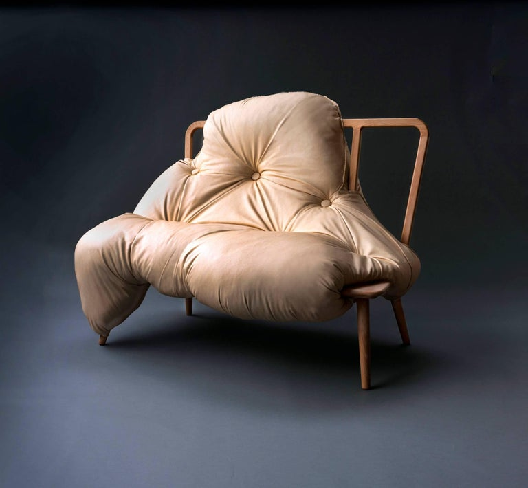 My Big Fat sofa narrates the bond between a person and their sofa. Together they sit as one, the upholstery spills and bulges, enveloping the wooden frame as a marriage of two mediums. The biomorphic seat is unsettling and inviting both at once.