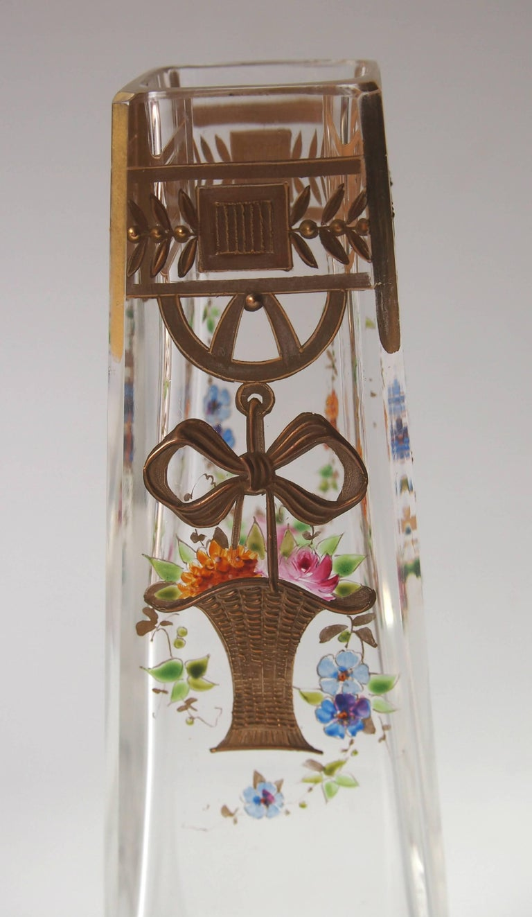 Super late Victorian Harrach clear cut, polychrome enameled and gilded vase depicting a basket of blooms suspended from a bow. Unusually the original design is recorded in the Harrach design books (see last picture).  Harrach has been the backbone