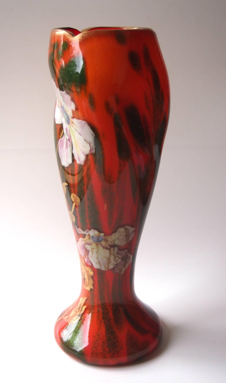Art Nouveau vase by Harrach in a rare and unusual colourway - opaque orange cased with green aventurine - Harrach were the only company to be known to use this colour combination. The vase is gilded and enamelled with flowers.  Harrach has been
