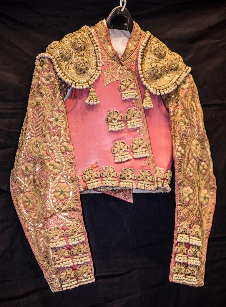 One of a kind matador costume in silk embroidered in gold from a Madrid workshop. Consists of three pieces, vest, gillet and trousers. The owner was a known  Matador and stockbreeder from Salamanca, Spain. Size 38.