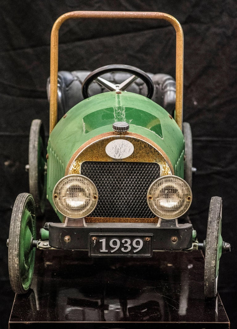 A mid 20th century toy car in green painted metal, model from 1939.  An amazing toy and an extraordinary decorative object in a very good condition.