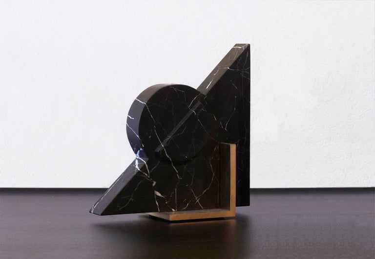 Meet Hemi; one of the new Oh So Single Odd bookend personalities. You can now mix and match colors and shapes throughout our range. Hemi is available in black marble and a brushed brass base. The marble is hand carved into the geometric shape,