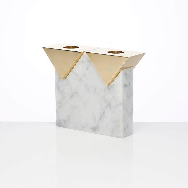 A double candleholder based on the architecture of our iconic Invisible Cities candleholders. A honed Carrara tower balances two polished brass triangular pieces. The brass has been polished to a mirror finish and left untreated which will develop