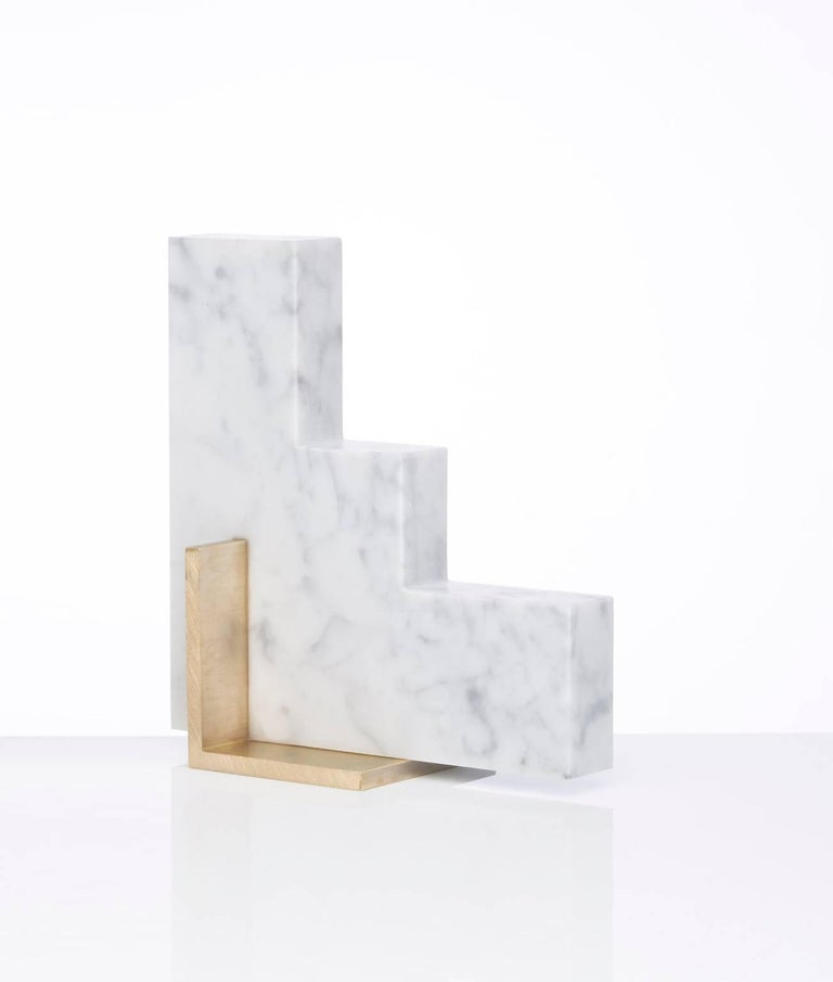 Meet Steppy; one half of the odd couple bookends set which are now available to buy individually. You can now mix and match colors and shapes. Steppy is shown here in Carrara marble and a brushed brass base. The marble is cut into a geometric