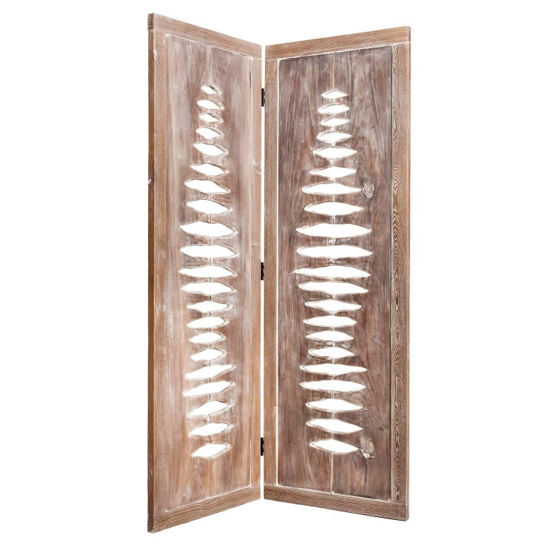 This sculptural space divider was inspired by images of primitive forms and vertebrae. Each panel stands approximately 77