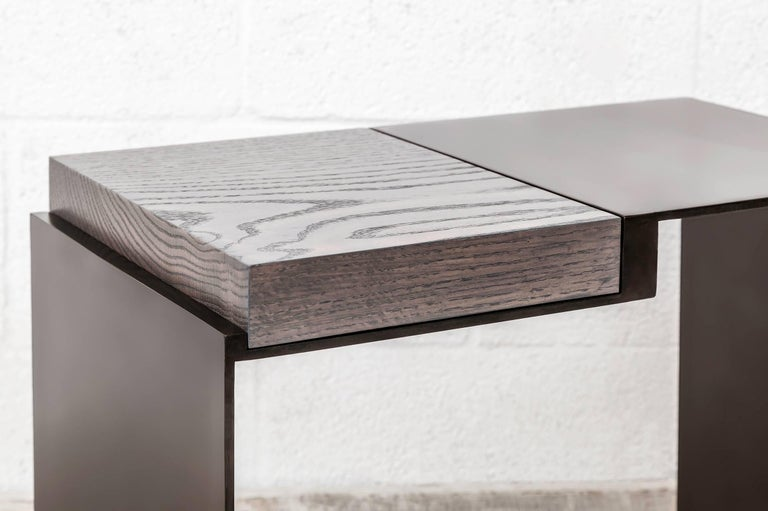 American 'Roque' contemporary side table in black patinated steel and solid oak For Sale