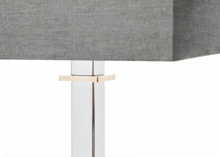 The 'Axis-Paris' lamp shown here is made of solid stainless steel and bronze. All metals are high polished to a mirrored finish. This lamp is available in floor lamp version as well as other metals, combinations and various finishes. A standard