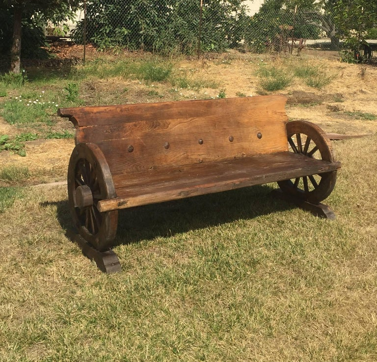 Rustic Bench With Antique Wheels And Iron Studs For Sale At 1stdibs