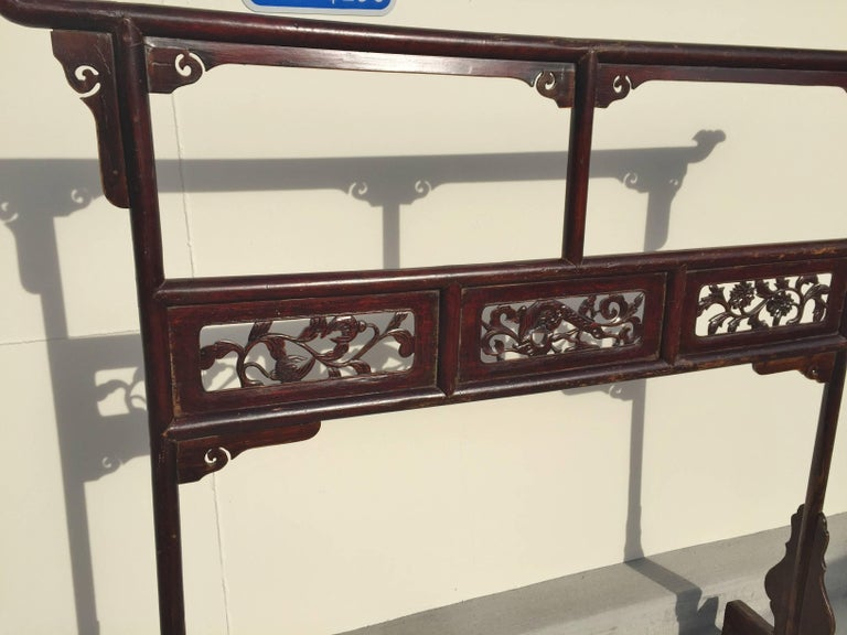 The garment rack is an unique piece of furniture used by the Chinese nobleman and noblewoman. Typically placed in a bedroom, it holds the robes they wear.  This beautiful piece features carved panels depicting flowers and water dragon. Delicate