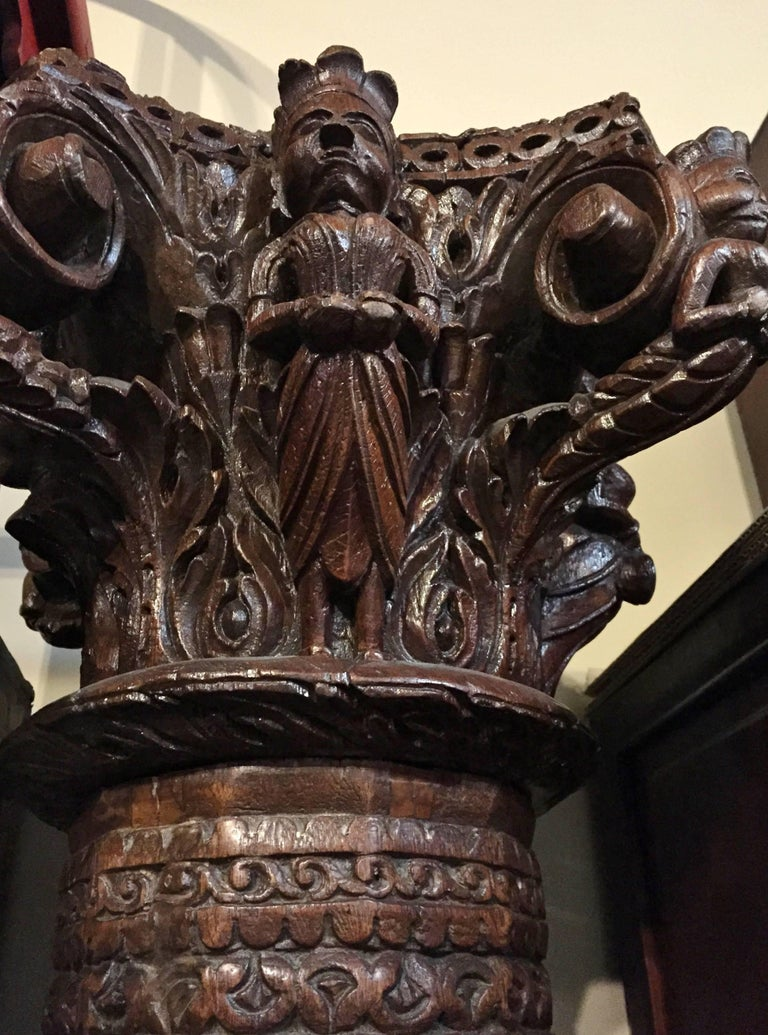 "This extraordinary 88"" tall column has its original granite base, is made out of solid teak wood featuring an elaborately carved crown. The crown is carved on all four sides with each side featuring a different musician. Beautiful scroll works"