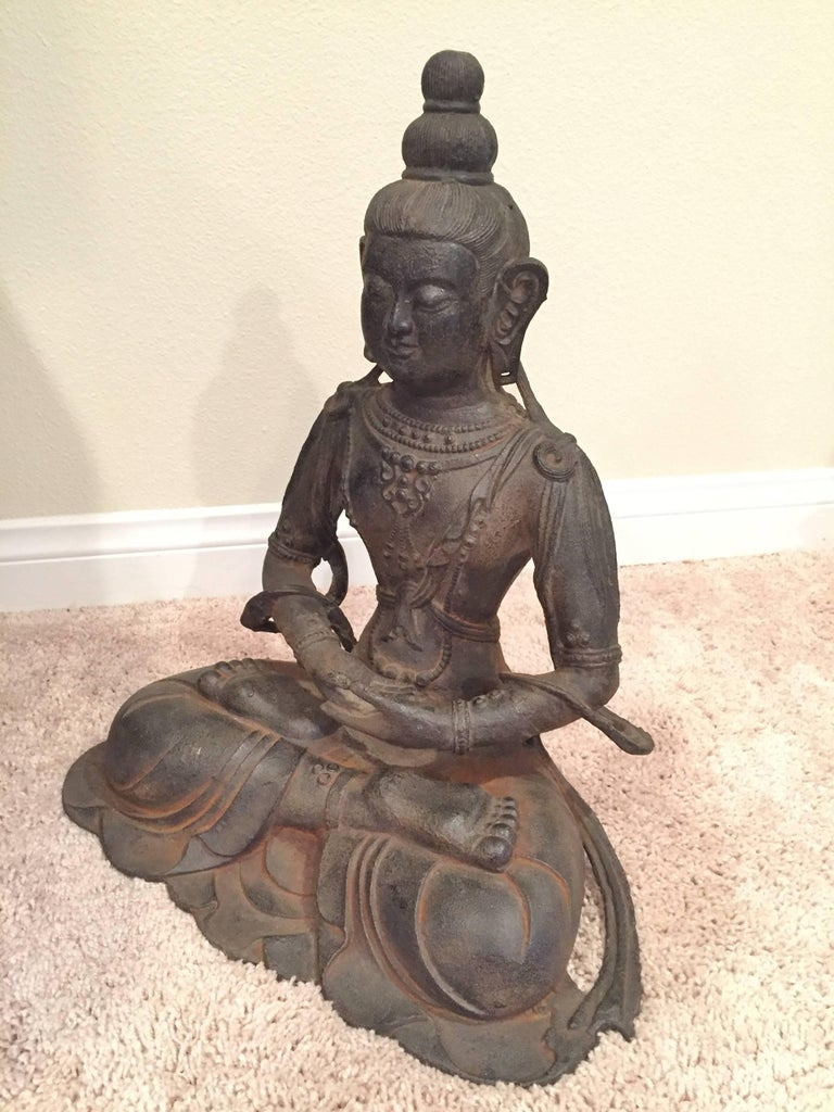 A very large iron Buddha statue. 