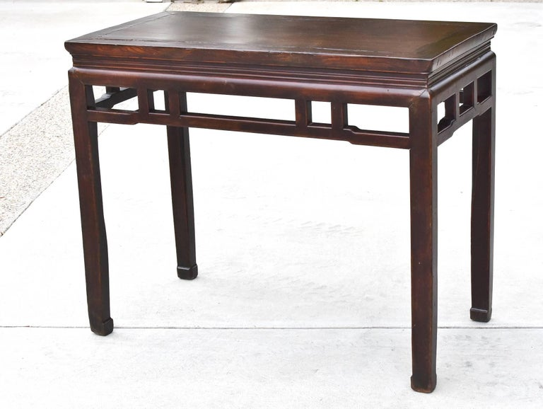 This piece demonstrates all the hallmarks of a Ming dynasty furniture. Choice of beautiful woods and elegant, simple lines make the table timeless. Straight non-fussy stretchers and hoof legs. The table is finished all around and the perfect size to