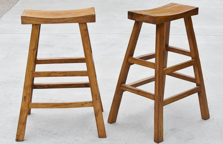 A pair of beautiful solid wood bar stools. 