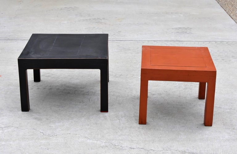 Two nice Parsons table made with solid wood. Beautiful black and orange red lacquer. These elegant tables makes great coffee tables, side tables, stools and stands for sculptures. Solid wood.