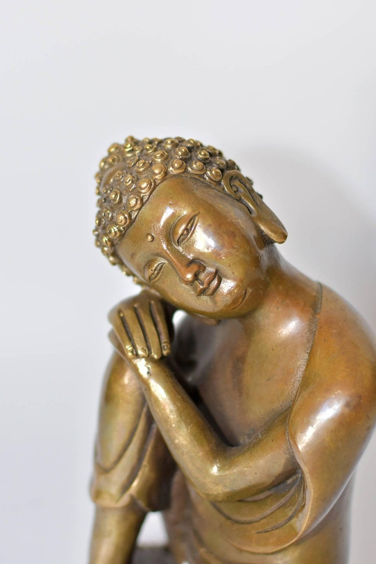 A beautiful brass contemplative Buddha. This is a rare version of Buddha depiction, in an unique style. Through fine craftsmanship, the statue conveys a sense of peace and calm. This piece is small and exquisite, perfect as a desk top sculpture and