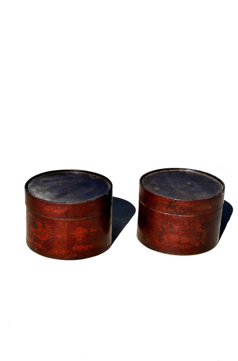 A pair of beautiful round boxes. Boxes are hand-painted with flowers and vases. Crackled patina enhances the charm.