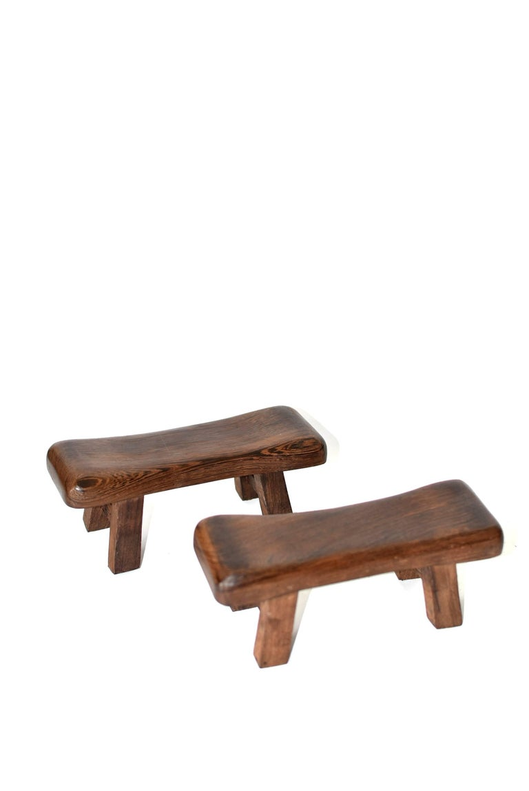 Beautiful miniature stools are made of the most spectacular wenge wood. This type of wood has very distinctive wood grains. It is highly prized for its density and scenic, romantic grain pattern. These stools can be used as headrest, hand rests in