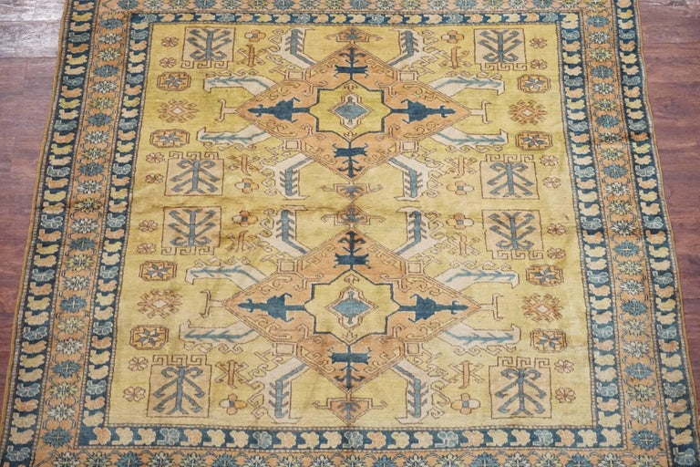 Antique square Caucasus Kazak rug  circa 1900  Measure: 6' x 6'  Hand-knotted wool pile on a cotton foundation  Field color: Gold Border color: Salmon Accent color: Ivory, navy-blue, light-blue.