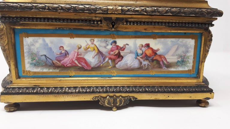 A rare antique French gilt bronze and silver Sevres porcelain casket finely painted with neoclassical figures on two round and two rectangular plaques.